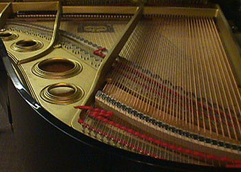 a photo of the inside of grand piano